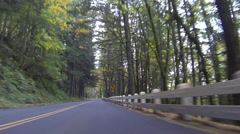 GoPro perspective of car driving on mountain road Stock Footage
