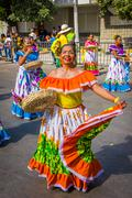 Performers with colorful and elaborate costumes participate in C Stock Photos