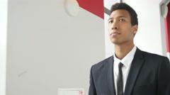 Serious Black Businessman Walking in Office, Indoor Stock Footage