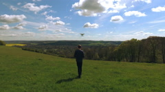 Aerial Shot Of Man Flying Drone Over Countryside Stock Footage