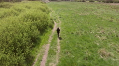 Aerial Shot Of Woman Walking Along Path In Countryside Stock Footage