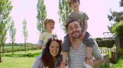 Parents Give Sons Ride On Shoulders During Walk Shot On R3D Stock Footage