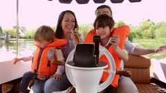 Family Enjoying Day Out In Boat On River Shot On R3D Stock Footage