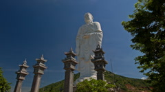 Pedestal of Large White Marble Buddha Statue in Temple Park Stock Footage