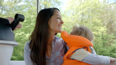 Mother And Son Enjoy Ride In River Boat Shot In Slow Motion Stock Footage