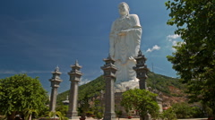 Close Large White Buddha Statue High Columns in Temple Park Stock Footage