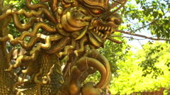 Close Large Golden Dragon Head Sculpture in Pond Temple Park Stock Footage