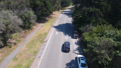 Aerial Drone Fly Over Street cars driving tracking Golden gate Park Stock Footage