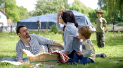 Slow Motion Sequence Of Family Enjoying Riverside Picnic Stock Footage