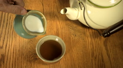 Slow motion overhead shot of tea being poured Stock Footage