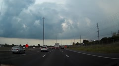 POV driving towards severe thunderstorm in city Stock Footage
