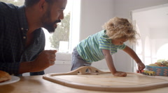 Father And Son Playing With Toy Train Set Stock Footage