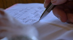 Close up of pen writing letter on table Stock Footage