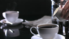 Slow motion shot of milk being poured into coffee cup Stock Footage