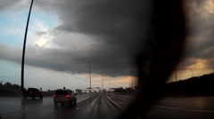 POV driving towards storm on highway in the rain Stock Footage