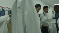 4K Workers getting ready in white protective clothing Stock Footage