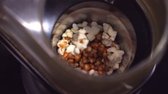 Slow motion shot of popcorn popping Stock Footage