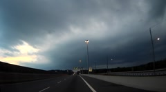 POV driving towards storm with tornado warning in effect Stock Footage