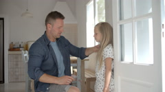 Father Measuring Daughter's Height Against Wall Stock Footage