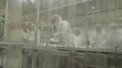 4K Workers in pharmaceutical manufacturing facility factory Stock Footage