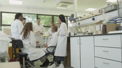 4K Young student scientists in group meeting Stock Footage