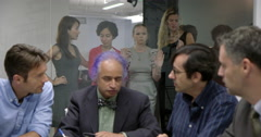 Men hold business meeting as women stand outside conference room 4K Stock Footage