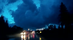 POV driving towards big thunder storm at night under tornado warning Stock Footage
