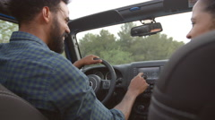 Couple Driving Open Top Car On Country Road Stock Footage