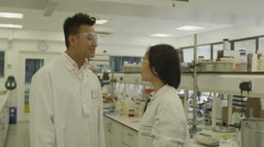 4K Portrait of young scientists with science team in lab Stock Footage