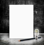 Blank White poster with lightbulb and pencil in a glossy concrete floor and b Stock Illustration