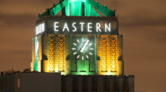 Time Lapse of the Eastern Clock Building at Night - Los Angeles Stock Footage