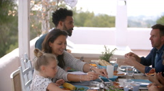 Families Enjoying Outdoor Meal On Terrace Together Stock Footage