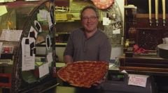 Small business owner with pizza - 4K Stock Footage