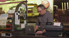 Small business owner working at cash register - 4K Stock Footage
