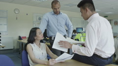 4K Two Asian people in meeting with black male manager Stock Footage