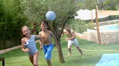 Father And Children Having Fun On Water Slide In Garden Stock Footage