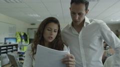 4K Businesswoman and businessman mull over data Stock Footage