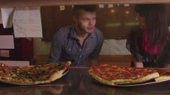 Friends buying pizza slices - 4K Stock Footage