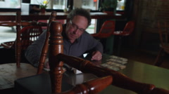 Small business owner counting cash at restaurant - 4K Stock Footage