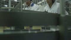 4K Pharmaceutical factory quality control staff Stock Footage