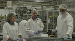 4K Workers in protective clothing in pharmaceutical Stock Footage