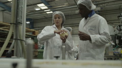 4K Two quality control workers in pharmaceutical factory Stock Footage
