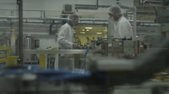 4K Workers in pharmaceutical factory inspect medical Stock Footage
