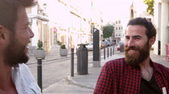 Two male friends talking at a table outside a cafe, Ibiza, shot on R3D Stock Footage