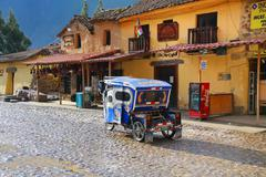 Auto rickshaw in the street of Ollantaytambo, Peru Stock Photos