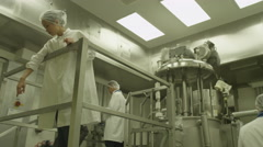 4K Scientists in pharmaceutical research factory. Stock Footage