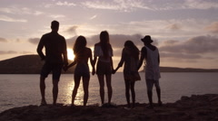 Friends Standing On Cliff Watching Sunset Shot On R3D Stock Footage