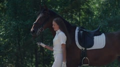 Beautiful girl riding a horse in countryside. The suit rider Stock Footage
