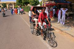 Cycle rickshaw driving in the streets of Jaipur, Rajasthan, India Stock Photos