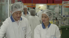 4K Asian man and woman working together as a team Stock Footage